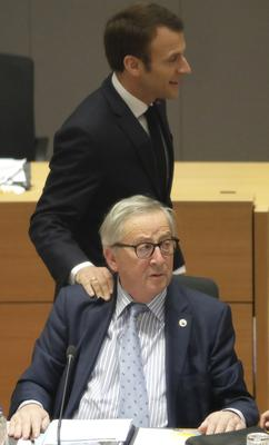 Emmanuel Macron greets European Commission President Jean-Claude Juncker as the EU27 debated Brexit in Brussels (AP Photo/Olivier Matthys, Pool)