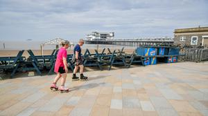 People rollerblade on the promenade at Weston-super-Mare (Ben Birchall/PA)