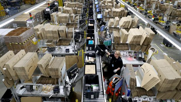 Customer orders are hand-packed at the Amazon Fulfilment Centre in the run-up to Black Friday (Gareth Fuller/PA)