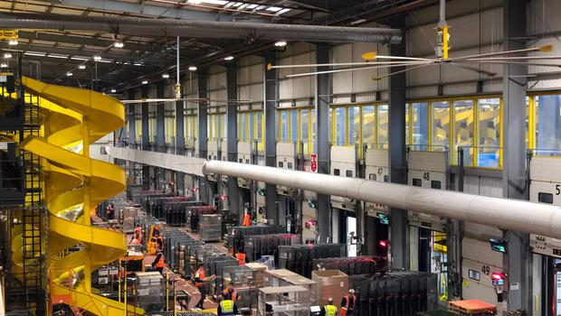 The back of the Amazon Fulfilment Centre in Dunfermline, Fife, where items are put on delivery vehicles (Douglas Barrie/PA)