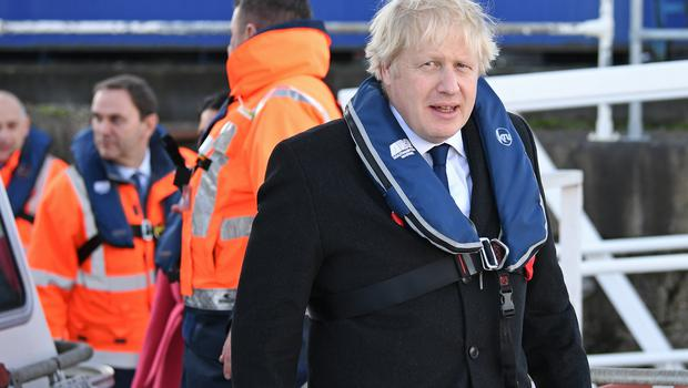 The Prime Minister dons a life vest for a trip to the Port of Southampton (Stefan Rousseau/PA)