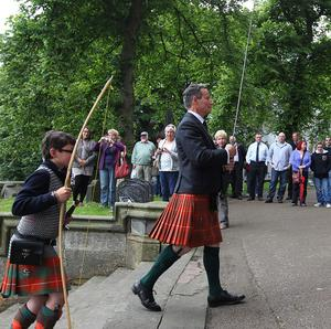 Lord Bruce DL, bearing the Sword of King Robert I of Scots, accompanied by The Hon. Benedict Bruce arrives for a service to commemorate the victory of Bannockburn