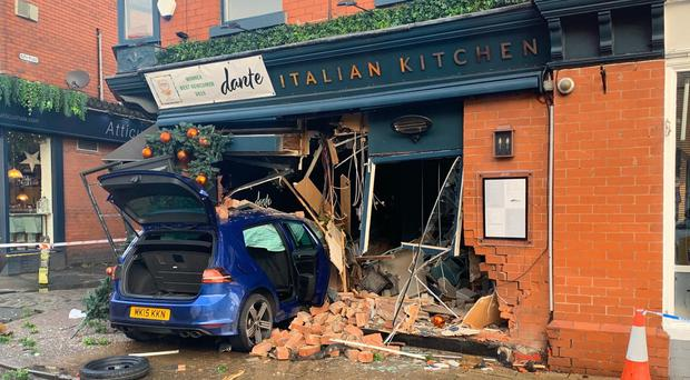 The scene on Ashley Road in Hale, Cheshire, after a car crashed into the front of the Dante Italian Kitchen restaurant (Peter Byrne/PA)