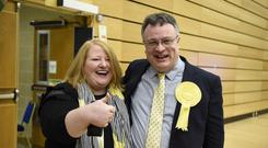 Stephen Farry of the Alliance Party with party leader Naomi Long after he won the North Down constituency (Michael Cooper/PA)