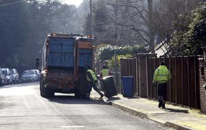 Council workers empty bins (Steve Parsons/PA)