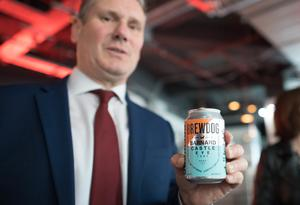 Labour leader Keir Starmer holding a can of Barnard Castle Eye Test beer (Stefan Rousseau/PA)