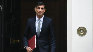 Chancellor of the Exchequer Rishi Sunak departs 11 Downing Street, in Westminster, London, to deliver a summer economic update at the Houses of Parliament (Stefan Rousseau/PA)