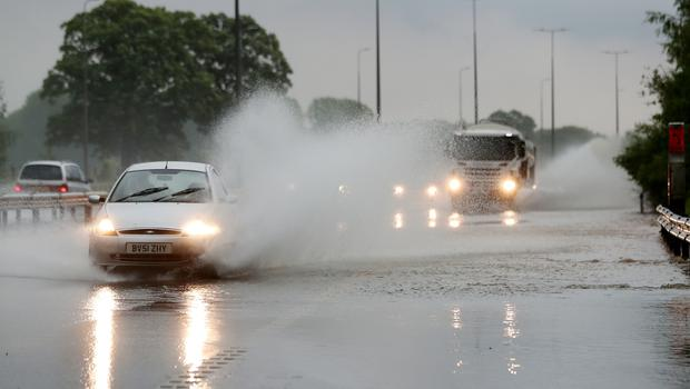 Traffic on the M42 go through standing water after heavy rain. (David Davies/PA)