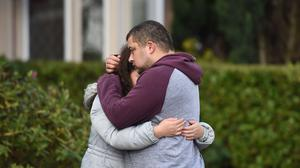 Reece Platt-May, the father of brothers Corey and Casper, hugs his sister Tia Fletcher close to the scene where the boys, aged six and two, were killed (Joe Giddens/PA)