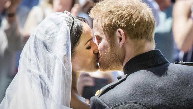 Sealed with a kiss: Harry and Meghan on the the steps of St George's Chapel (Danny Lawson/PA)