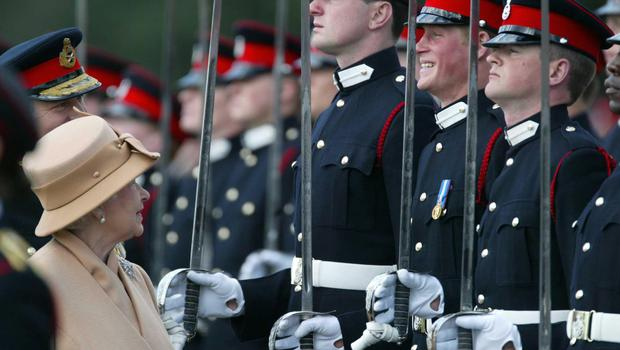 Prince Harry smiles broadly as his grandmother the Queen reviews him and other officers during The Sovereign's Parade at Sandhurst (James Vellacott/PA)