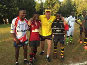 Rwandan rugby players with charity worker Glyn Watkins (centre right) wearing kits donated by teams based in Wales (Friends of Rwandan Rugby)