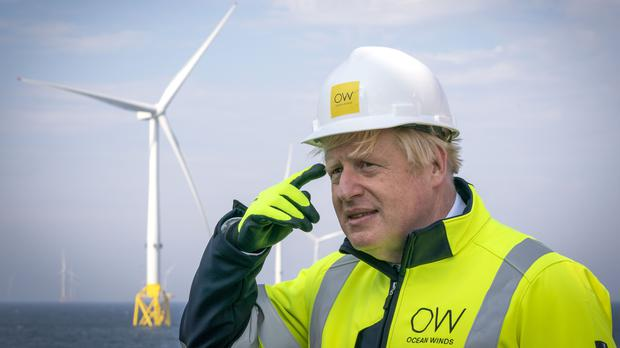 Prime Minister Boris Johnson on board the Esvagt Alba during a visit to the Moray Offshore Windfarm East, off the Aberdeenshire coast (Jane Barlow/PA)