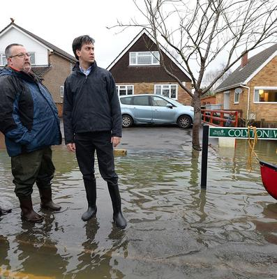 """Ed Miliband has attacked David Cameron for giving up the fight against climate change and said the winter storms should serve as a """"wake-up call"""""""