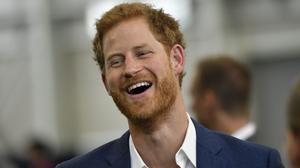 Prince Harry watched on as school children got soaked during a visit to a conservation project (Arthur Edwards/The Sun/PA)