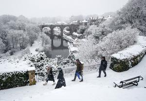 People walk in the snow near Knaresborough Viaduct in North Yorkshire (Danny Lawson/PA)