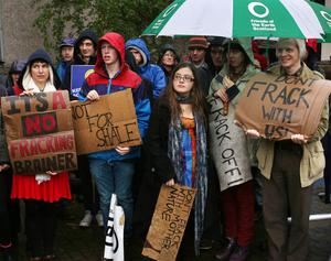 Protesters take part in an anti-fracking demonstration outside the SNP conference in 2013 (David Cheskin/PA)