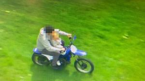The rider was on parkland with the child allegedly balanced in his lap (West Midlands Police/PA)