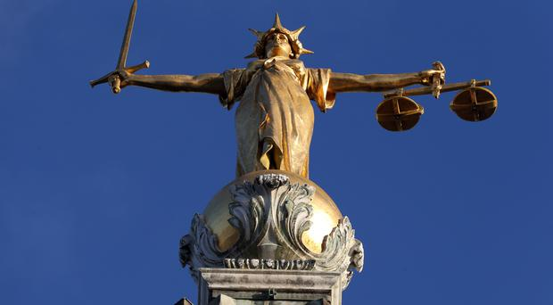 File photo dated 8/1/2019 of FW Pomeroy's Statue of Lady Justice atop the Central Criminal Court building at the Old Bailey, London. (Jonathan Brady/PA)