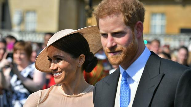 The Duke and Duchess of Sussex at a garden party at Buckingham Palace (Dominic Lipinski/PA)