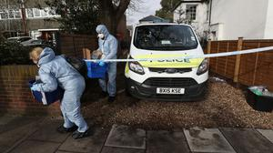 Forensic officers at a property in Twickenham where a woman was found dead with stab wounds (Jonathan Brady/PA)