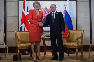 Mrs May and Mr Putin looking happier, during their first meeting in 2016. (Stefan Rousseau/PA Wire)