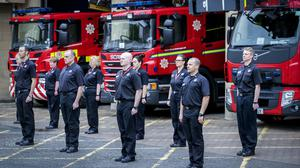 Green Watch and station staff at Tollcross Community Fire Station in Edinburgh observe a minute's silence (Jane Barlow/PA)