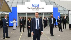 Health Secretary Matt Hancock and NHS staff stand at the opening of the NHS Nightingale Hospital (Stefan Rousseau/PA)