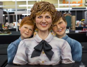 A younger version of Harry, with his mother Diana and brother William, was the design chosen by one baker (Aaron Chown/PA)