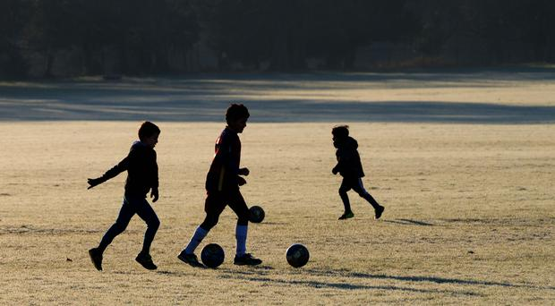 Children could be banned from heading the ball in Scotland (John Walton/PA)