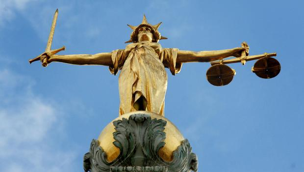 Efforts to modernise the justice system are examined in a new report (Clara Molden/PA)