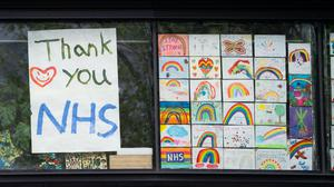 Rainbow drawings in the window of DLD College, London, as the UK continues in lockdown to help curb the spread of the coronavirus (Aaron Chown/PA)