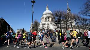 Competitors pass St Paul's Cathedral during the 2019 London Landmarks Half Marathon (Steven Paston/PA)