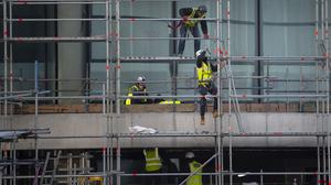 Construction workers on a residential building (Victoria Jones/PA)