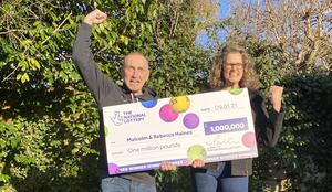 Malcolm and Rebecca Haines celebrate their £1 million Lotto win at their home in Reading, Berkshire. (Camelot/PA)
