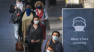 Face coverings are or will be mandatory on public transport in some parts of the UK as lockdown restrictions are eased (Victoria Jones/PA)