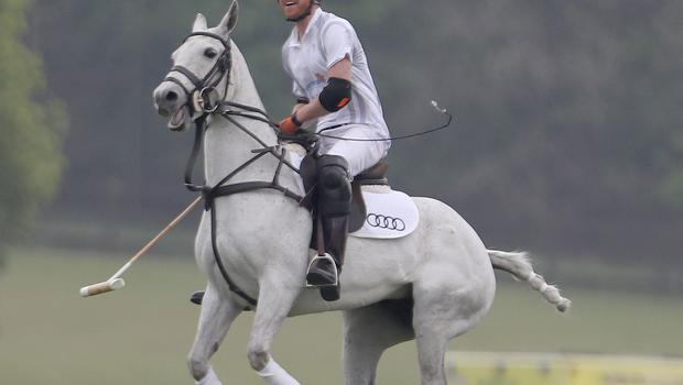 Prince Harry takes part in the annual Audi Polo Challenge at Coworth Park polo club in Ascot, Berkshire (Steve Parsons/PA)