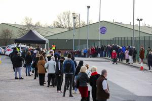 People queue at a Coronavirus testing centre at the Liverpool Tennis Centre in Wavertree, part of the mass Covid-19 testing in Liverpool (Peter Byrne/PA)