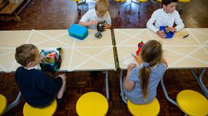 Children of essential workers eat lunch in segregated positions at Kempsey Primary School in Worcester (Jacob King/PA)