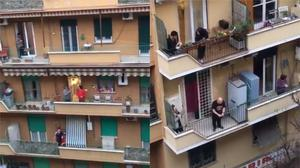 People gather on their balconies in Rome to sing the national anthem during the coronavirus lockdown (Yemi Adeyeye)