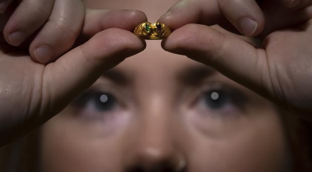 Curator of archaeology at York Museums Trust Lucy Creighton inspects the ring (Danny Lawson/PA)