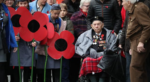 Remembrance Sunday brought together young and old (Andrew Milligan/PA)