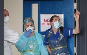 Staff cheer at Aintree University Hospital (Peter Byrne/PA)