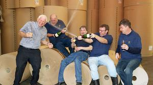 David King, Gary Smith, Phillip Mellon, Peter Howard and Andrew Howard said that they have no plans to quit their jobs as machine operators after winning the lottery