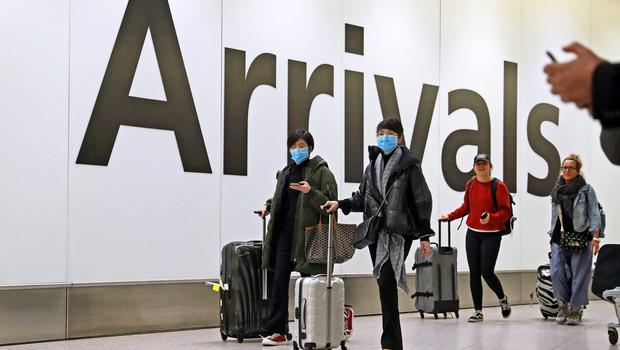 Passengers in the arrivals concourse at Heathrow Terminal 4, London (Steve Parsons/PA)