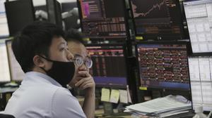"""Stock markets have endured further volatile trading as investors remained nervous after the """"Black Monday"""" meltdown saw the worst day for London blue chips since the 2008 financial crisis. (Ahn Young-joon / AP)"""