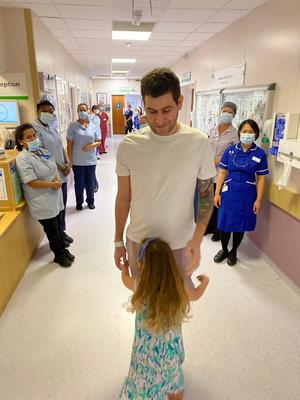 Omar Taylor with his daughter Vivienne before leaving hospital (Kaitlyn Taylor/PA)