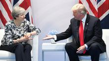 Theresa May has asked Donald Trump to help broker a deal in a bitter aerospace trade dispute (Stefan Rousseau/PA)