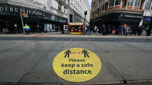 A social distancing guidance sign on the pavement in Manchester city centre (Danny Lawson/PA)