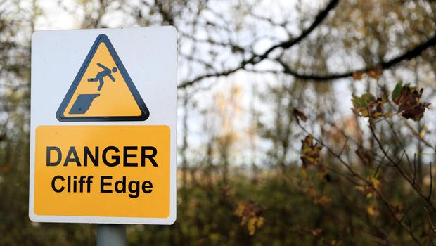 A warning sign along Berry Hill Road that backs on to the edge of the quarry wall which forced the evacuation of residents of Bank End Close, Mansfield. PA Photo. Picture date: Friday November 8, 2019. Parts of England endured a month's worth of rain in 24 hours, with scores of people rescued or forced to evacuate their homes, others stranded overnight in a shopping centre, and travel plans thrown into chaos. See PA story WEATHER Rain. (Simon Cooper/PA)